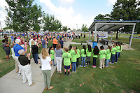 NWA Democrat-Gazette/ANDY SHUPE<br /> Community members gather Thursday, Sept. 10, 2015, during a dedication ceremony for the Kiwanis International Centennial Playground at the renovated Luther George Grove Street Park in Springdale. The playground comes as a part of Kiwanis' national effort to build playgrounds to mark the organization's 100-year anniversary.