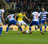 Leeds United's Jack Harrison (center) battles with Reading's Liam Moore (left) &amp; Andy Yiadom (right) <br /> <br /> Photographer David Horton/CameraSport<br /> <br /> The EFL Sky Bet Championship - Reading v Leeds United - Tuesday 12th March 2019 - Madejski Stadium - Reading<br /> <br /> World Copyright &copy; 2019 CameraSport. All rights reserved. 43 Linden Ave. Countesthorpe. Leicester. England. LE8 5PG - Tel: +44 (0) 116 277 4147 - admin@camerasport.com - www.camerasport.com