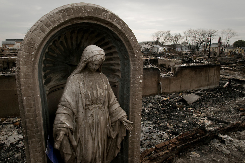 Statue of a Saint survived the fire which burned to the ground 101 houses in Breezy Point, NY during Hurricane Sandy.