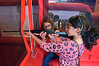 NWA Democrat-Gazette/BEN GOFF -- 04/26/15 Emily Holly (left), 12, of Bella Vista, a member of the Benton County 4-H Ozarks Youth Shooting Team, shows Emely (CQ) Solis, 10, of Centerton how to shoot a Daisy Model 74 BB gun in the Daisy inflatable BB gun range set up at the FLW Expo at the John Q. Hammons Center in Rogers on Sunday Apr. 26, 2015.