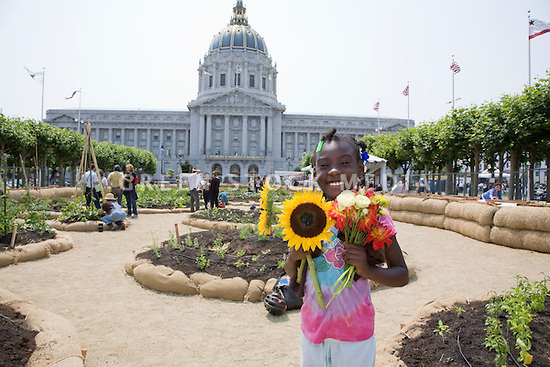 "Volunteer participant Kaylah Frazier smiles at the close of Community Planting Day (July 12, 2008) of the Slow Food Nation Victory Garden at San Francisco's Civic Center. The garden project ""demonstrates the potential of a truly local agriculture practice that unites and promotes Bay Area urban gardening organizations, while producing high quality food for those in need.""* The garden is planted on the same site as the post-World War II garden sixty years ago. The food will be grown over a period of two months, harvested, and donated to people in need..*slowfoodnation.org"