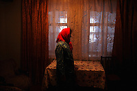 Natasha stands inside her farmhouse in the village of Chobruchi, Transnistria on 16 April 2009.