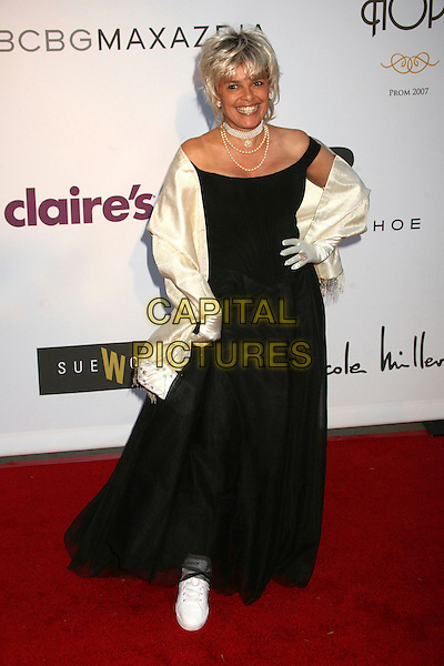 """SHARI BELAFONTE.1st Annual """"Class of Hope Prom 2007"""" Charity Benefit at the Sportman's Lodge, Studio City, California, USA. .April 21st, 2007.full length black gown dress off the shoulder cream pashmina satin purse bag sneakers trainers hand on hip .CAP/ADM/BP.©Byron Purvis/AdMedia/Capital Pictures"""