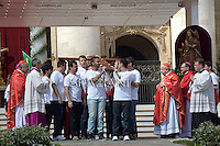 Brazilian boys exchange the Cross of the World Youth Day with Polish boys (JMJ) next to the cardinal of Krakow Stanislaw Dziwisz during the Palm Sunday Mass celebrated by Pope Francis at St. Peter's Square on April 13, 2014