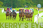 The Pier (pink and sky blue) ridden by WJ Lee outsprints Destined for Fame (black and Amber), Street Hawk (green and white), Mallorey (maroon with blue circles), Champion Boy (yellow and blue) and Ravati (maroon with blue) to win the Randles Hotels Killarney Handicap Ruth Magnier and Anita Baggott Killarney at the Killarney Races on Monday