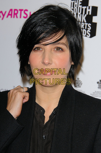 SHARLEEN SPITERI .Attending the South Bank Sky Arts Awards, The Dorchester Hotel, London, England, UK, 25th January 2011..portrait headshot black shirt hand .CAP/CJ.©Chris Joseph/Capital Pictures.