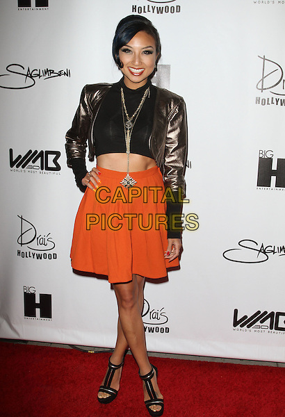 Jeannie Mai.The World's Most Beautiful Magazine Launch Event held at Drai's in Hollywood, California, USA..August 10th, 2011.full length black top cropped gold bronze jacket orange skirt belly stomach midriff necklace   .CAP/ADM/KB.©Kevan Brooks/AdMedia/Capital Pictures.
