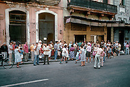 June, 1977. Havana, Cuba. Eighteen years after the Cuban Revolution the first U.S. tourists were permitted to visit Havana. U.S. tourists in Habana Vieja, visiting the National Museum, buying cigars, posters and drinking on the Havana Cathedral Plaza.