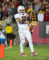 LOS ANGELES, CA - November 16, 2013:  Stanford Cardinal running back Tyler Gaffney (25) celebrates his touchdown during the Stanford Cardinal vs the USC Trojans at Los Angeles Memorial Coliseum in Los Angeles, CA. Final score Stanford Cardinal 17, USC Trojans  20.