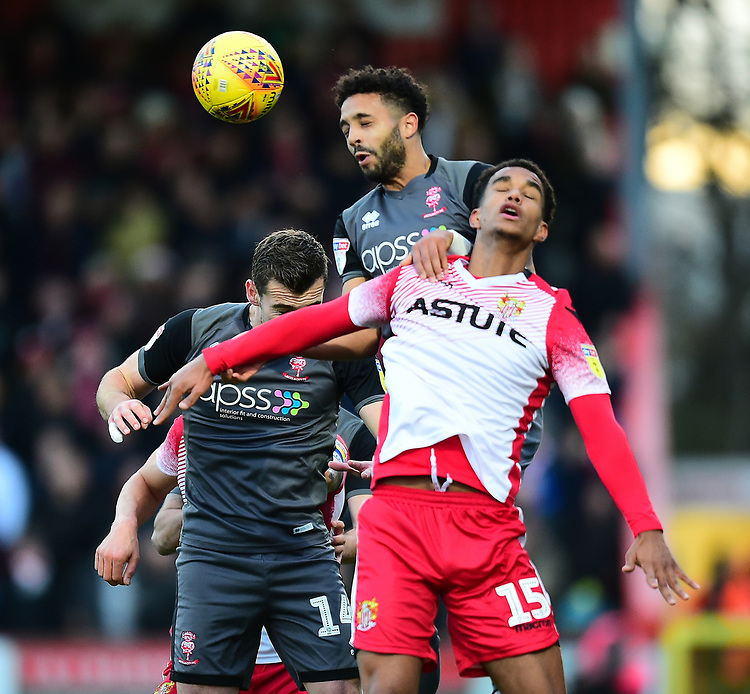 Lincoln City's Bruno Andrade vies for possession with  Stevenage's Terence Vancooten<br /> <br /> Photographer Andrew Vaughan/CameraSport<br /> <br /> The EFL Sky Bet League Two - Stevenage v Lincoln City - Saturday 8th December 2018 - The Lamex Stadium - Stevenage<br /> <br /> World Copyright © 2018 CameraSport. All rights reserved. 43 Linden Ave. Countesthorpe. Leicester. England. LE8 5PG - Tel: +44 (0) 116 277 4147 - admin@camerasport.com - www.camerasport.com