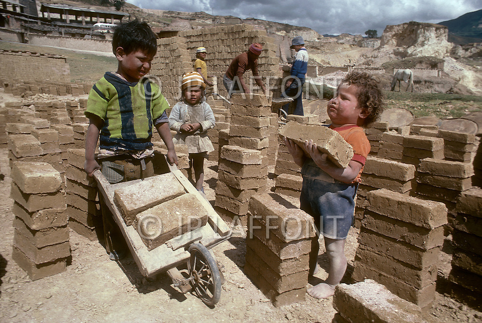 Children employed at a brick manufactuer outside Bogota, Colombia - Child labor as seen around the world between 1979 and 1980 - Photographer Jean Pierre Laffont, touched by the suffering of child workers, chronicled their plight in 12 countries over the course of one year.  Laffont was awarded The World Press Award and Madeline Ross Award among many others for his work.