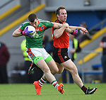 Mark Mc Carthy of Kilmurry Ibrickane in action against Podge Mc Mahon of Clondegad during their senior county final at Cusack park. Photograph by John Kelly.