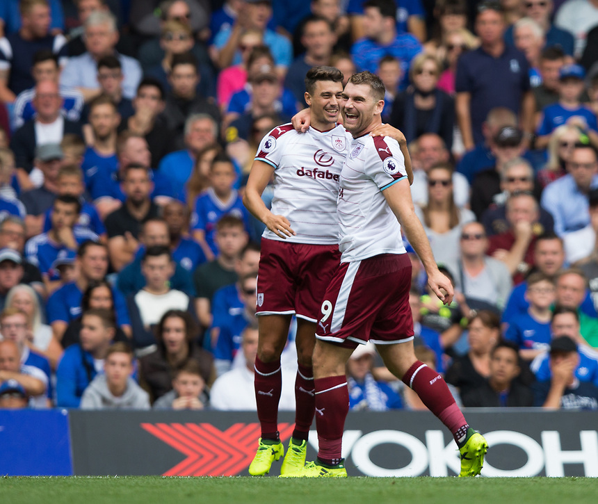 Burnley's Sam Vokes celebrates scoring the opening goal with team mate Matthew Lowton<br /> <br /> Photographer Craig Mercer/CameraSport<br /> <br /> The Premier League - Chelsea v Burnley - Saturday August 12th 2017 - Stamford Bridge - London<br /> <br /> World Copyright &copy; 2017 CameraSport. All rights reserved. 43 Linden Ave. Countesthorpe. Leicester. England. LE8 5PG - Tel: +44 (0) 116 277 4147 - admin@camerasport.com - www.camerasport.com