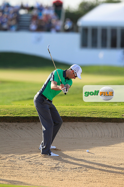 Ross Fisher (ENG) plays his 2nd shot from a fairway bunker on the 18th hole during Saturday's Round 3 of the 2013 Portugal Masters held at the Oceanico Victoria Golf Club. 12th October 2013.<br /> Picture: Eoin Clarke www.golffile.ie