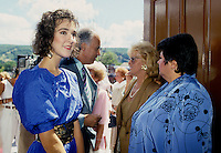 Montreal (Qc) CANADA - August 8, 1987 file photo of Rene Angelil (M) , manager of singer Celine Dion (L) , Danielle Ouellet (M-R) amd Ginette Reno (R) at Rene Simard and Marie-Josee Taillefer wedding , north of Montreal