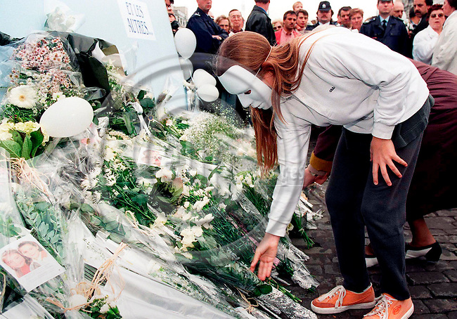 BRUSSELS - BELGIUM - 20 OCTOBER 1996--The biggest demonstration in the history of Belgium took place sunday in Brussels OKT. 20, 1996 for the victims of the pedofil Dutroux-gang. Here a girl putting flowers  in memory of the dead and missing girls after the long march through Brussels.--PHOTO: EUP-IMAGES..