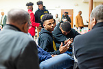"WATERBURY,  CT-011820JS24-- Tyriq James-Ireland, center, join in a discussion with mentors during a breakout session at the ""Men with a Purpose"" luncheon, a Dr. Martin Luther King, Jr. event celebrating men, Saturday at Grace Baptist Church in Waterbury. The event was sponsored by the Waterbury NAACP Youth Council.<br /> Jim Shannon Republican-American"
