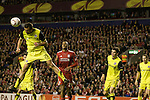 24.02.2011 Europa League Football from Anfield Liverpool v Sparta Prague. Sparta defender Erich Brabec (yellow shirt) makes a clearing header in his own penalty area watched by Liverpool forward David Ngog in the second half.