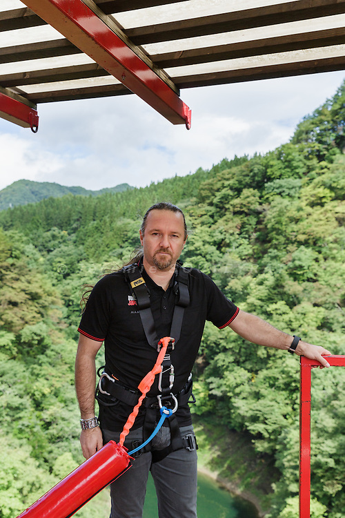 Minakami, Gunma prefecture, Japan, September 29 2016 - Beau Retallick is an Australian citizen based in Japan and the founder of Bungy Japan, a pioneer bungy jumping company in Japan. Beau Retallick is also an inventor and uses the money earned from bungy jumping to various projects. His latest invention is a jet powered drone with enough thrust to levitate a sumo wrestler.<br /> Beau Retallick poses before jumping at Sarugakyo bungy jumping bridge.