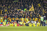 Borussia Dortmund players sit down in front of their fans after victory against Tottenham Hotspur during the UEFA Europa League match between Tottenham Hotspur and Borussia Dortmund at White Hart Lane, London, England on 17 March 2016. Photo by David Horn / PRiME Media Images