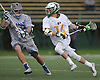 Ryan Slane #14 of LIU Post, right, gets pressured by Jon Lynott #27 of New York Institute of Technology during the the ECC men's lacrosse championship at LIU Post on Saturday, May 7, 2016. Slane recorded two goals and an assist in Post's 12-11 win.