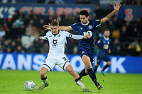 George Byers of Swansea City battles with Lewis Travis of Blackburn Rovers during the Sky Bet Championship match between Swansea City and Blackburn Rovers at the Liberty Stadium in Swansea, Wales, UK. Wednesday 11 December 2019