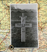 BNPS.co.uk (01202 558833)<br /> Pic: BeechAuctions/BNPS<br /> <br /> Grave in Rheinburg cemetery, Germany.<br /> <br /> Sold for £700, after being rescued from a waste bin - the tragic tale of a doomed Lancaster crew - shot down on its last mission over Germany, on Christmas Eve 1944, the pilots 21st birthday...<br /> <br /> The poignant archive belonged to the family of Flt Sgt Ernest McGuire, wireless operator on the doomed Lancaster Bomber ND388 that set off on Christmas eve 1944.<br /> <br /> The aircraft was due to fly to it's 30th and final operation in Cologne from RAF Grimsby but never made it to its destination.