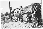 K-36 #483 (probably) wrecked and sitting on a siding with a string of cars loaded with wreck material.<br /> D&amp;RGW