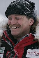 Paul Gebhart is smiles at the Nikolai checkpoint after having lost his team in the Farewell Burn area from a broken gangline.