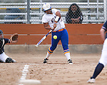 Wildcats' Briauna Carter hits against Snow College at Edmonds Sports Complex in Carson City, Nev., on Friday, March 20, 2015. <br /> Photo by Cathleen Allison