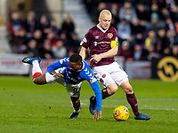 26th January 2020, Tynecastle Park, Edinburgh, Scotland; Scottish Premier League football, Hearts of Midlothian versus Rangers; Steven Naismith of Hearts  and Jermain Defoe of Rangers compete for possession of the ball