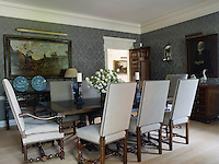 The dining room was designed around Dolores Halpern's collection of Delft and 17th century Dutch paintings