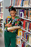 High school student age 16 researching in Macalester College Library.  St Paul Minnesota USA