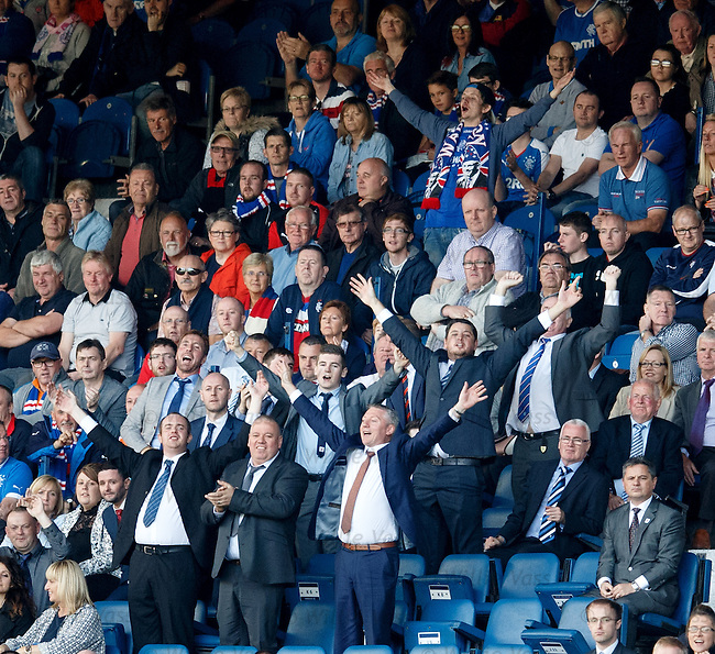 Rangers fans dancing and singing after the goal rush