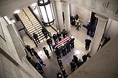 WASHINGTON, DC - DECEMBER 03: A military honor guard team readies the casket of former U.S. President George H. W. Bush before bringing it into the U.S. Capitol Rotunda December 3, 2018 in Washington, DC. A state funeral for former U.S. President Bush will be held in Washington over the next three days, beginning with him lying in state in the Rotunda of the Capitol until Wednesday morning. (Photo by Win McNamee/Getty Images)