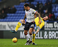 Bolton Wanderers' Josh Magennis competing with Leeds United's Pontus Jansson<br /> <br /> Photographer Andrew Kearns/CameraSport<br /> <br /> The EFL Sky Bet Championship - Bolton Wanderers v Leeds United - Saturday 15th December 2018 - University of Bolton Stadium - Bolton<br /> <br /> World Copyright &copy; 2018 CameraSport. All rights reserved. 43 Linden Ave. Countesthorpe. Leicester. England. LE8 5PG - Tel: +44 (0) 116 277 4147 - admin@camerasport.com - www.camerasport.com