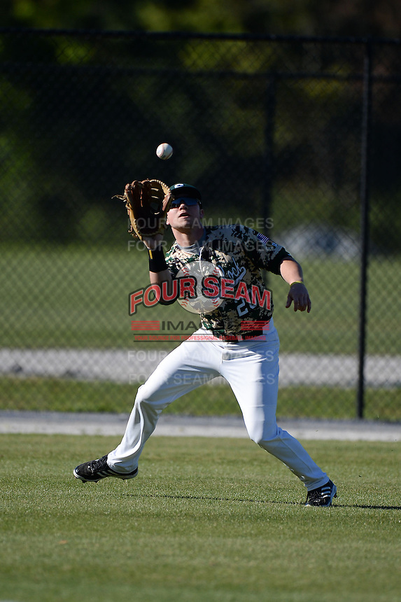 Slippery Rock outfielder Adam Urbania (20) catches a fly ball during a game against Upper Iowa University at Frank Tack Field on March 14, 2014 in Clearwater, Florida.  Slippery Rock defeated Upper Iowa 14-9.  (Mike Janes/Four Seam Images)