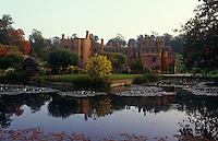 A view of Compton Wynyates across the ornamental pond