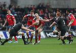 Münster hooker Duncan Casey goes for a gap in the Ospreys defence.<br /> RaboDirect Pro12<br /> Ospreys v Munster<br /> Liberty Stadium<br /> 23.02.14<br /> <br /> ©Steve Pope-SPORTINGWALES