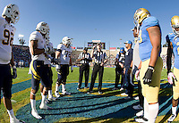 California and UCLA captains watch referee Land Clark tosses a coin during the coin toss ceremony before the game at Rose Bowl in Pasadena, California on October 29th, 2011.  UCLA defeated California, 31-14.