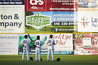 (L-R) Pulaski Yankees outfielders Antonio Cabello (22), Madison Santos (58), and Ryder Green (21) stand for the National Anthem prior to the game against the Burlington Royals at Calfee Park on September 1, 2019 in Pulaski, Virginia. The Royals defeated the Yankees 5-4 in 17 innings. (Brian Westerholt/Four Seam Images)