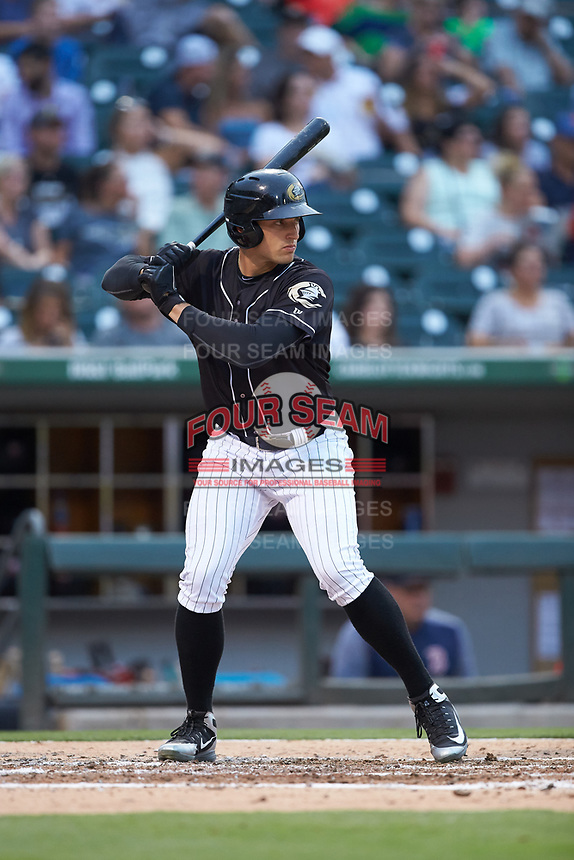 Trayce Thompson (4) of the Charlotte Knights at bat against the Pawtucket Red Sox at BB&T BallPark on July 19, 2018 in Charlotte, North Carolina. The Knights defeated the Red Sox 4-3.  (Brian Westerholt/Four Seam Images)