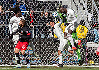 WASHINGTON, DC - FEBRUARY 29: Andre Shinyashiki #99 and Kei Kamara #23 of the Colorado Rapids clash with Bill Hamid #24 of DC United during a game between Colorado Rapids and D.C. United at Audi Field on February 29, 2020 in Washington, DC.