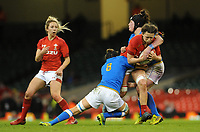 Wales Alisha Butchers  is tackled by Italy&rsquo;s Melissa Bettoni and  Elisa Giordano<br /> <br /> Photographer Ian Cook/CameraSport<br /> <br /> 2018 Women's Six Nations Championships Round 4 - Wales Women v Italy Women - Sunday 11th March 2018 - Principality Stadium - Cardiff<br /> <br /> World Copyright &copy; 2018 CameraSport. All rights reserved. 43 Linden Ave. Countesthorpe. Leicester. England. LE8 5PG - Tel: +44 (0) 116 277 4147 - admin@camerasport.com - www.camerasport.com