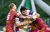 Picture by Allan McKenzie/SWpix.com - 11/05/2018 - Rugby League - Ladbrokes Challenge Cup - Huddersfield Giants v Wakefield Trinity - John Smith's Stadium, Huddersfield, England - Wakefield's Pauli Pauli fights through the tackles of Huddersfield's Paul Clough and Lee Gaskell.
