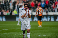 SWANSEA, WALES - APRIL 04: Neil Taylor of Swansea City  applauds fans as he leaves the field after the final whistle during the Premier League match between Swansea City and Hull City at Liberty Stadium on April 04, 2015 in Swansea, Wales.  (photo by Athena Pictures)