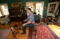 NWA Democrat-Gazette/ANDY SHUPE<br /> Willi Carlisle, a poet, songwriter, musician and playwright, works Friday, April 13, 2018, on his second album at Homestead Recording in Fayetteville.