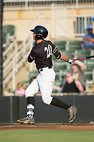 Blake Rutherford (20) of the Kannapolis Intimidators follows through on his swing against the West Virginia Power at Kannapolis Intimidators Stadium on July 20, 2017 in Kannapolis, North Carolina.  The Power defeated the Intimidators 6-5.  (Brian Westerholt/Four Seam Images)