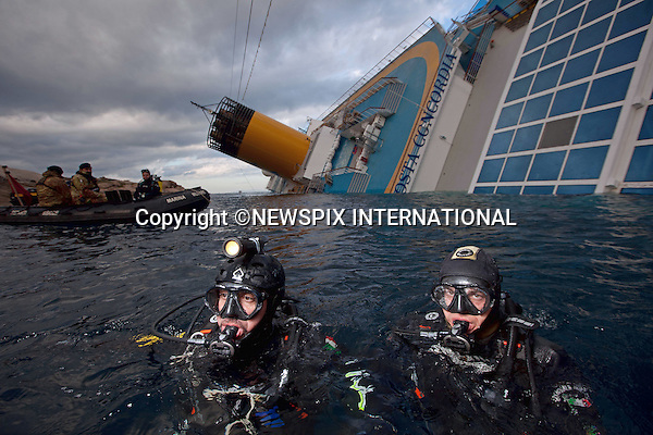 """EXCLUSIVE! : *** Telephone +441279 324672 FOR REPRODUCTION FEES ***.Isola di Giglio, Italy_16/01/2012:  COSTA CONCORDIA CRUISE TRAGEDY.Italian divers(or speleologists as they are known) carry out the dangerous task of finding survivors in a race against time, in the debris filled wreck of the luxury cruise ship Costa Concordia, that ran aground on Friday night near Isola del Giglio..The Costa Concordia which was carrying 4,200 people, experienced trouble a few hundred metres from the tiny Tuscan holiday island of Giglio on Friday evening as the passengers were at dinner, after apparently sailing off course..Mandatory Credit Photo: ©Sestini/NEWSPIX INTERNATIONAL..**ALL FEES PAYABLE TO: """"NEWSPIX INTERNATIONAL""""**..IMMEDIATE CONFIRMATION OF USAGE REQUIRED:.Newspix International, 31 Chinnery Hill, Bishop's Stortford, ENGLAND CM23 3PS.Tel:+441279 324672  ; Fax: +441279656877.Mobile:  07775681153.e-mail: info@newspixinternational.co.uk"""