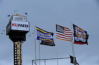 Flags fly at Kansas Speedway.